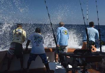 IGFTO Observer Greg Moore watches as the boat backs down on a blue marlin in the Dominican Republic.